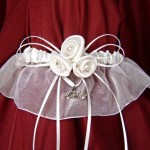 garter with motorcycle charm